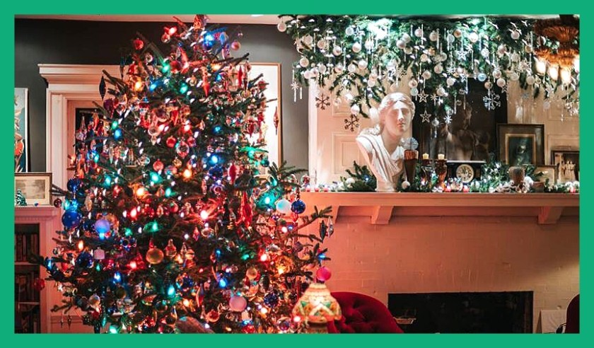 View of Christmas Tree and Fireplace Mantle decorated for Christmas