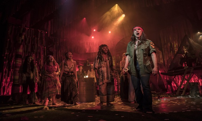 Paul Wilkins as Claude and the cast of HAIR THE MUSICAL