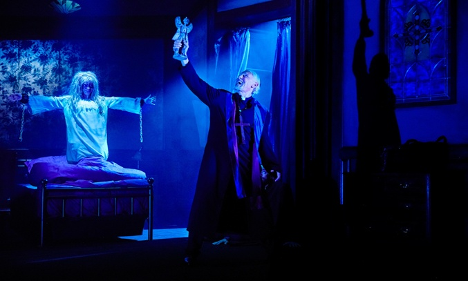 Eliza Capel (Regan) and Paul Nicholas (Father Merrin) in THE EXORCIS