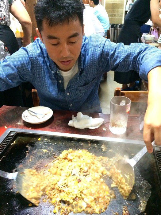 Tatsuya cooking me Monjayaki in Tokyo Japan