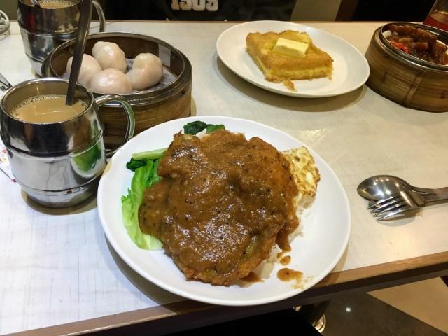 Pan fried Pork and egg for 50 HKD. Coffee in a metal mug