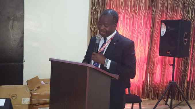 Dr. Kayode Ogunkunle Program Manager Oyo State Agency for the Control of AIDS (OYSACA) delivering a key Note Address at the Society for Family Health Global Fund HIV New Funding Model Extension Grants Close out/Dissemination meeting, held at Kakanfo Inn and Conference Center Ibadan, Oyo Sttae