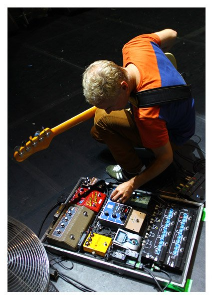 Paul Turner working on his pedalboard. Paul Turner is Jamiroquai's bass player.