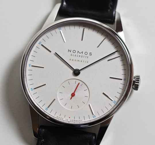 All Nomos Neomatik model with silver dial feature blue numbering and a red seconds hand