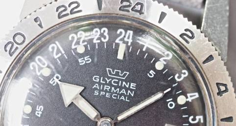 "It's not easy to see on the Glycine Airman, but note the little hole betwen the 2 and 4 of ""24"" on the dial where the wire comes through"