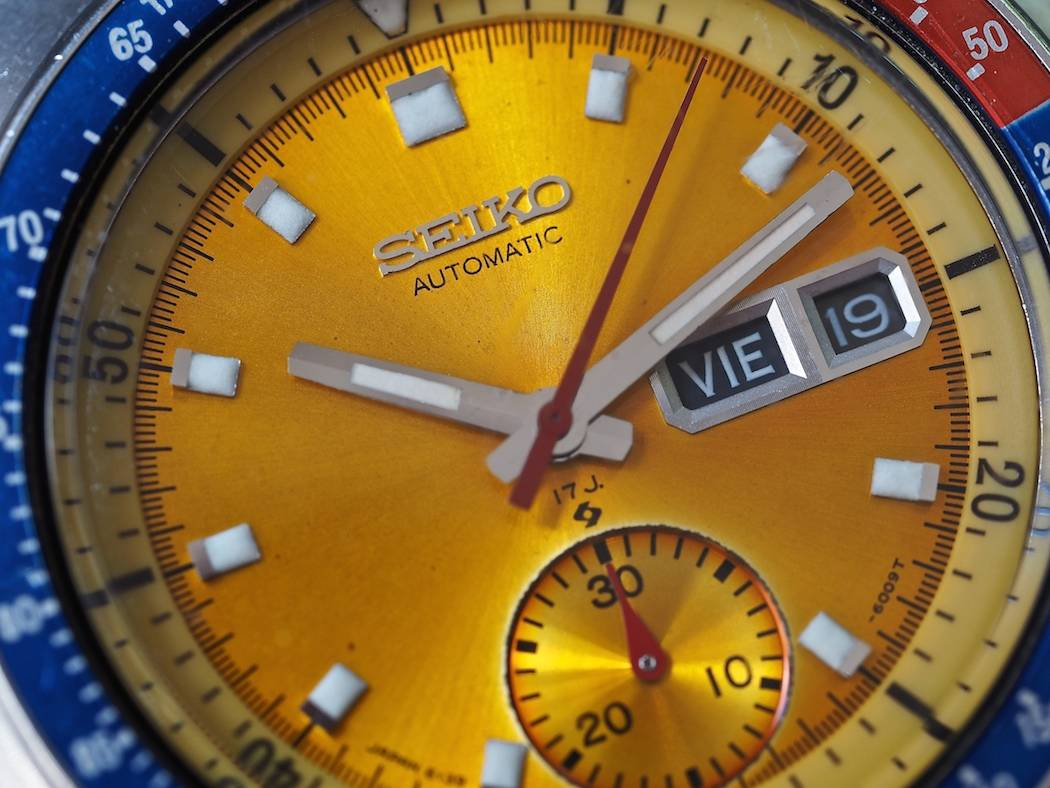 A look at the Seiko 6139 Pogue close up shows details such as the applied logo and the Suwa symbol