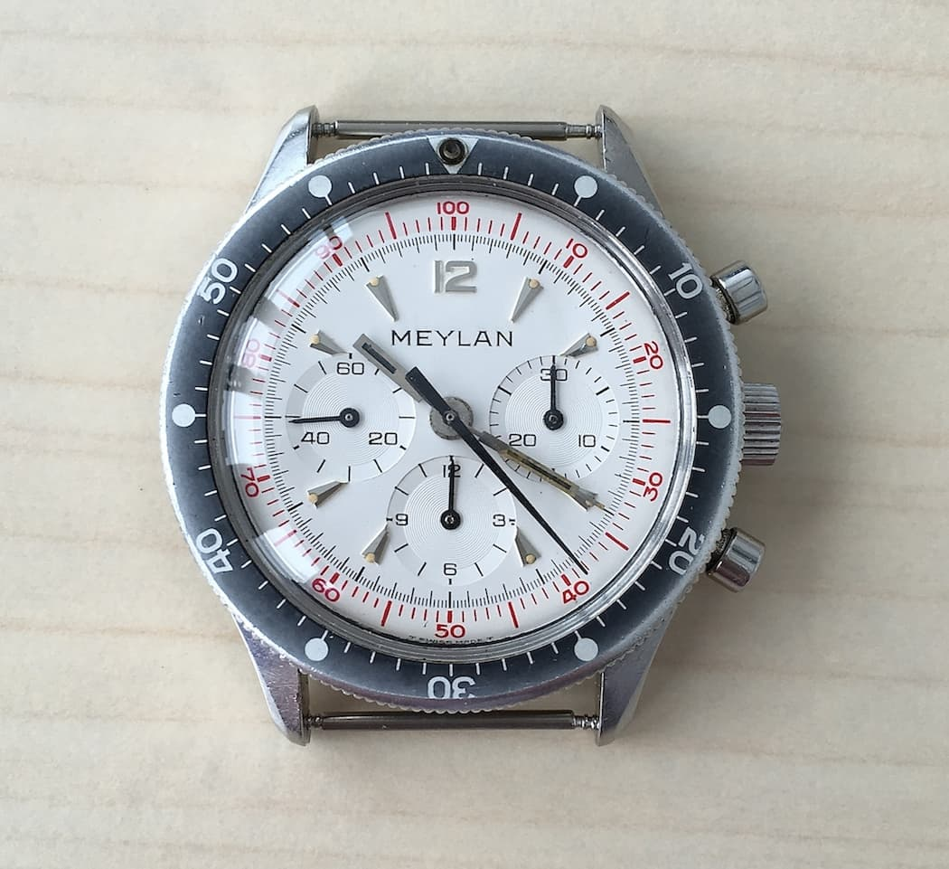 The red scale on the outer edge of the Meylan Chronograph is for measuring decimal time.