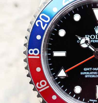 Rolex 16710 GMT-Master II bezel close-up