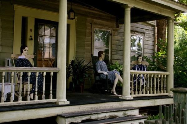 dolls on porch