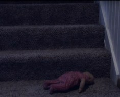 doll-on-stairs-haunted