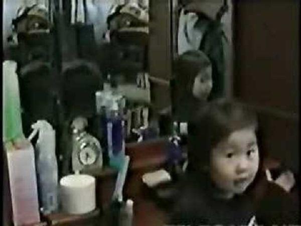 Strange mirror reflection Japanese girl