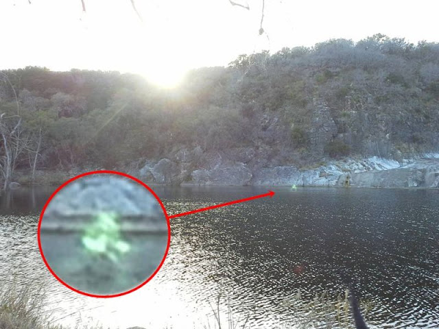 Marble Falls green ghost walking on water