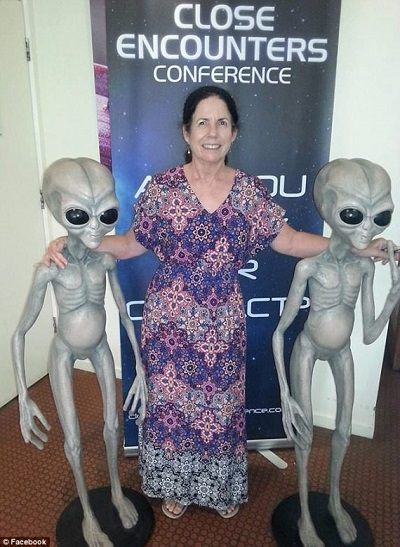Judy Carroll with Grey alien statues