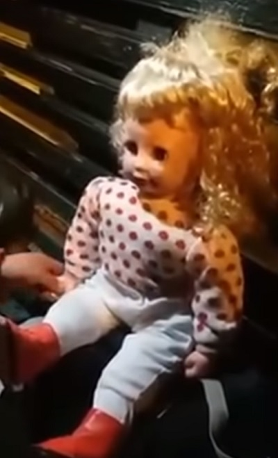 Possessed doll in Peru bench
