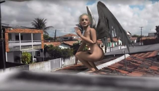 Female angel on rooftop in Brazil