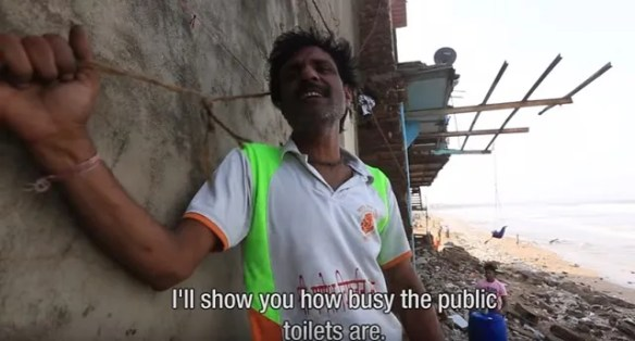 Man shows toilet Mumbai