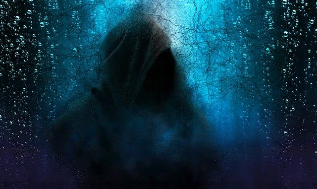 cloaked hooded figure