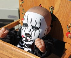 Creepy doll in a box