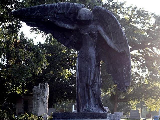 Black angel statue of Oakland Cemetery