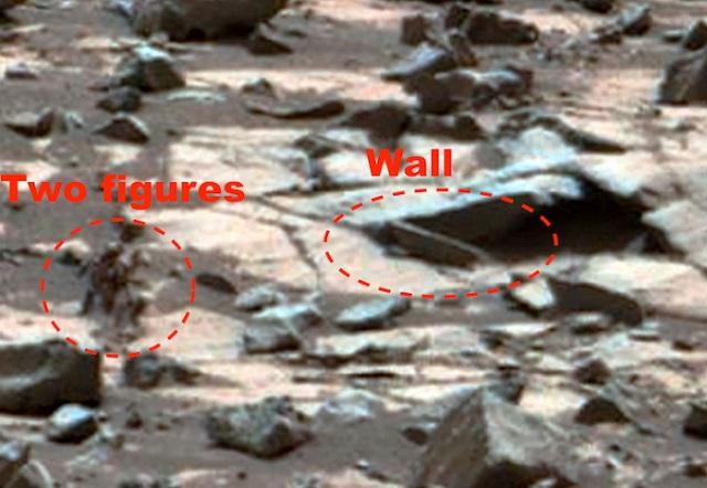 Two alien figures on Mars
