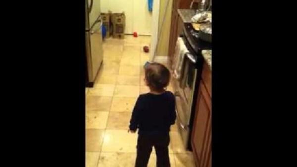 Toddler talks with spirit in kitchen