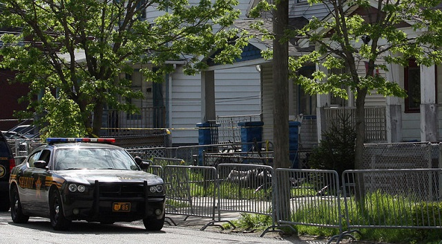 Woman found dead on fence
