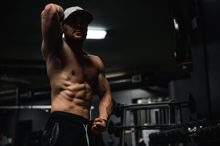 Man pose showing his bulk up body muscles