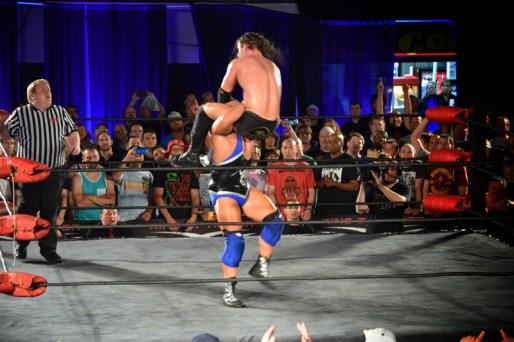 Elgin powerbombing Cole into oblivion.