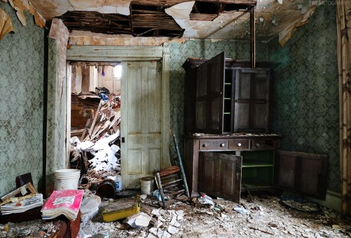 An antique hutch in the living room of an abandoned house in Ontario
