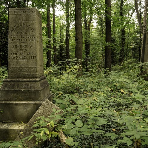 After spending a full day in an abandoned Tuberculosis Sanitarium on the walk back to my car I spotted a very old cemetery deep in the woods.