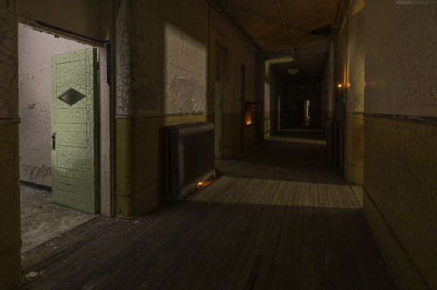 Using whatever light I can find to light up a pitch black hallway in an abandoned insane asylum.