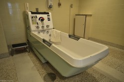 A hydrotherapy tub inside a vacant psychiatric hospital.