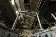 The exhaust system in the main floor of a massive vacant industrial food production plant