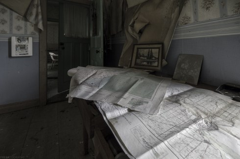 Two old maps of Southern Ontario in an abandoned house.