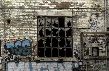 Broken windows inside an abandoned building in Toronto