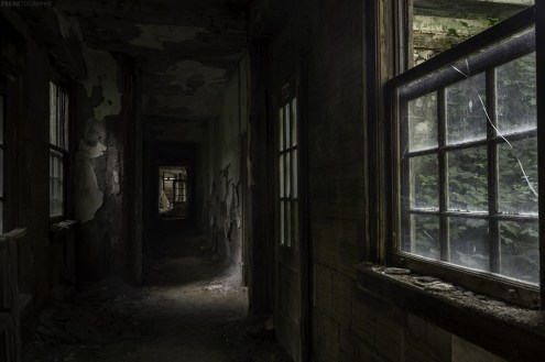 A long dark hallway in an abandoned building in New York State
