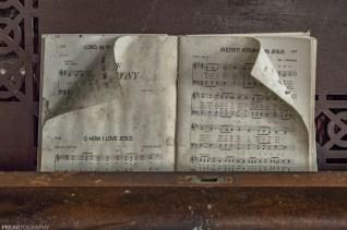 Sheet Music in Abandoned Church, abandoned, abandoned photography, abandoned places, creepy, decay, derelict, Freaktography, haunted, haunted places, photography, urban exploration, urban exploration photography, urban explorer, urban exploring