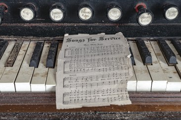 sheet music in an abandoned church
