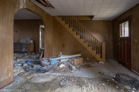 Freaktography, abandoned, abandoned photography, abandoned places, area rug, carpet, creepy, crumbling, decay, derelict, door, haunted, haunted places, living room, photography, stairs, urban exploration, urban exploration photography, urban explorer, urban exploring