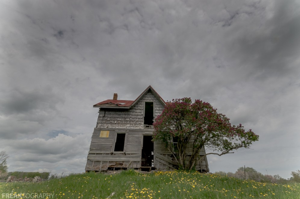 Freaktography, abandoned, abandoned house, abandoned photography, abandoned places, clouds, creepy, dandilions, dark clouds, decay, derelict, grass, haunted, haunted places, omnious sky, photography, sky, urban exploration, urban exploration photography, urban explorer, urban exploring