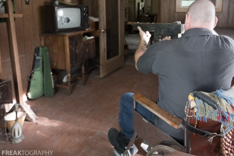 Freaktography having some fun with a toy gun and a TV with a bullet hole in it