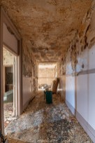 abandoned 1980s hotel crumbling hallway