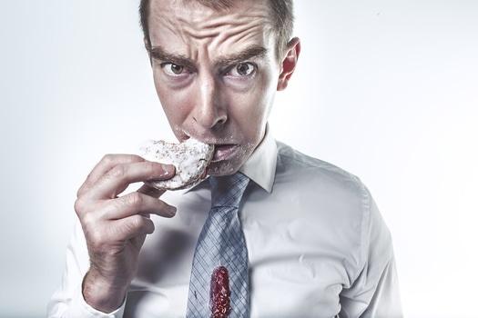 Man Eating Unhealthy Sugary Food