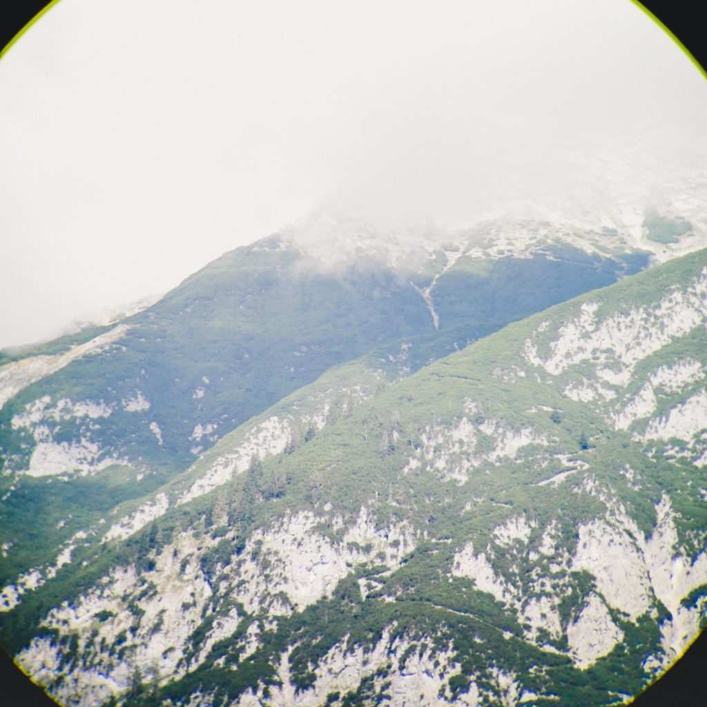 Mountainside through smartphone with optical zoom binocular
