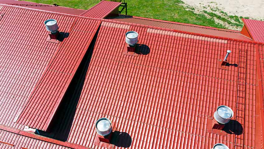 Red metal roofing structure