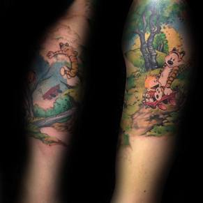 colorful-calvin-and-hobbes-mens-arm-tattoo