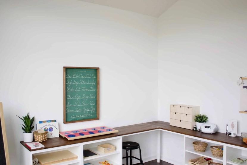 Montessori homeschooling room with corner desk
