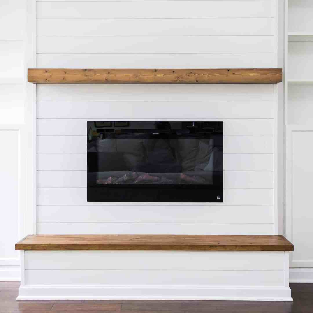 Modern farmhouse floating mantle above electric fireplace built-in