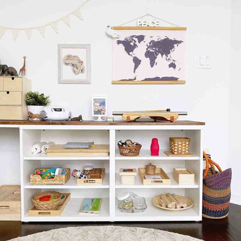Tour a Montessori-inspired schoolroom + playroom for multiple children at www.freeandunfettered.com. You can also download a free guide to help you design your own prepared environment for your children at home. #montessori #designingspacesforchildren #preparedenvironment #montessoriathome #homeschoolroom #homeschooling