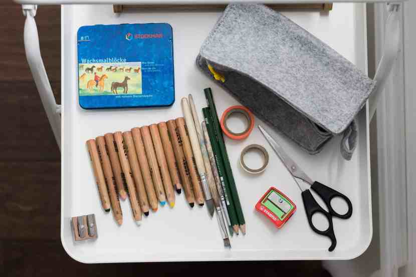 Some of our favorite art supplies and materials for children displayed on IKEA's VIGGJA Tray Cart, which is being used to make everything nicely accessible to them.